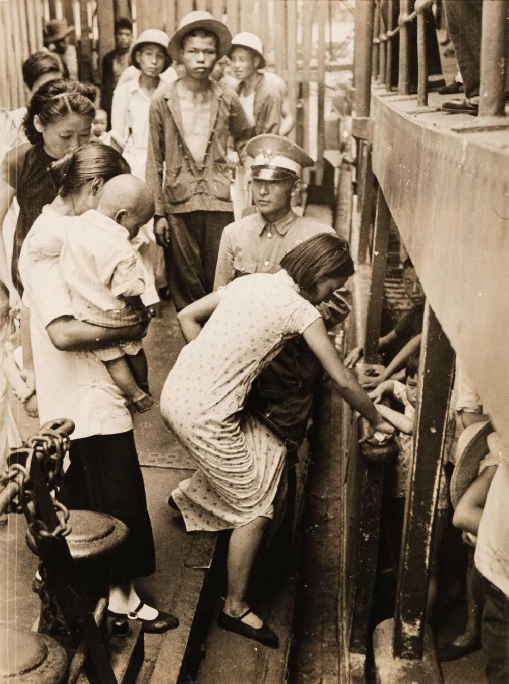 Lot 14 - Capa (Robert, 1913-1954). Hankow's War Orphans are Evacuated, 1938