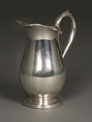 Lot 23 - Jug. Edwardian silver baluster jug by Cooper Brothers & Sons, Sheffield 1924