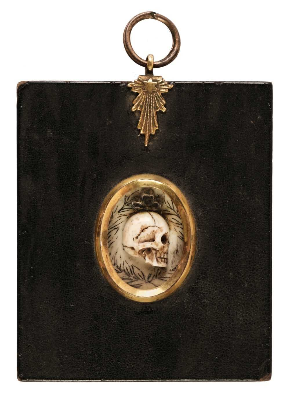 Lot 321 - Memento Mori. An oval miniature carved skull in profile, late 18th century
