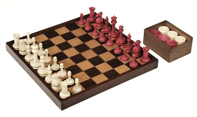 "Lot 250 - Chess. A 19th-century ivory ""Staunton"" pattern chess set"